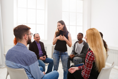 therapist talking with a rehab group
